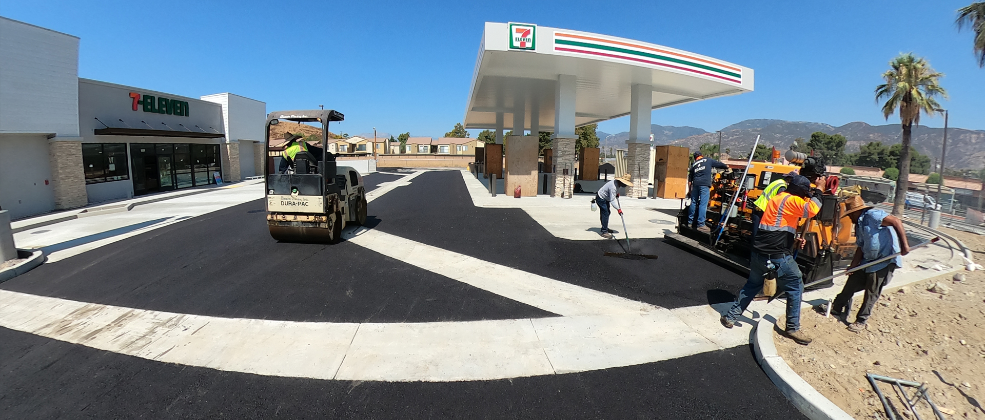 Fish Eye view of construstion team paving 7-eleven parking lot