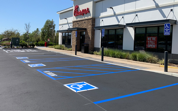 Wide shot of Chick Fil A parking lot that has been recently paved